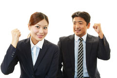 Smiling businessman and businesswomen Stock Images