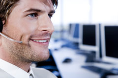 Smiling businessman in a call centre Stock Photography