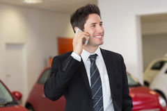 Smiling businessman calling with his mobile phone Royalty Free Stock Photo