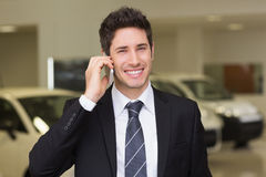 Smiling businessman calling with his mobile phone Royalty Free Stock Image