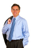 Smiling Businessman Carrying Suit Jacket Royalty Free Stock Photography