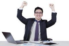 Smiling businessman celebrate his triumph Stock Photography