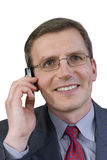 Smiling businessman with cell phone Royalty Free Stock Photography