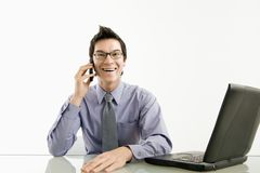 Smiling businessman on cell phone. Royalty Free Stock Photography