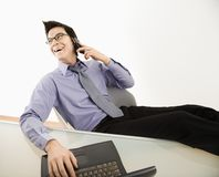 Smiling businessman on cell phone. Stock Photo