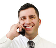 Smiling Businessman On Cell Phone. A handsome smiling businessman talking on his cell phone isolated over white Stock Photos