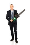Smiling businessman with chainsaw Stock Image