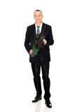 Smiling businessman with chainsaw Royalty Free Stock Image