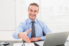 Smiling businessman on an chair office offering handshake Royalty Free Stock Photos