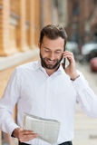 Smiling businessman chatting on his mobile Stock Photography