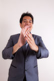 Smiling businessman clapping his hands Stock Images