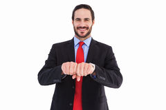 Smiling businessman with clenched fist in front of him Royalty Free Stock Photo