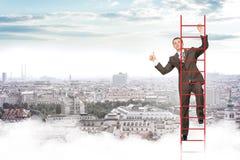 Smiling businessman climbing ladder in sky Stock Photos