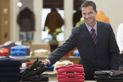 Smiling Businessman At Clothes Store Royalty Free Stock Photography
