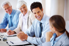 Smiling businessman with colleagues Royalty Free Stock Image