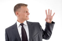 Smiling businessman counting fingers Stock Images