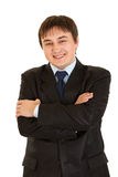 Smiling businessman with crossed arms on chest Stock Photography