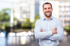 Smiling businessman with crossed arms Stock Photos