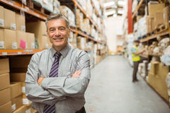 Smiling businessman with crossed arms Stock Image
