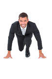 Smiling businessman crouching Stock Photo