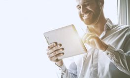 Businessman with digital tablet and earphones stock images