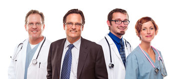 Smiling Businessman with Doctors and Nurses Stock Photo