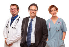 Smiling Businessman with Doctors and Nurses Stock Image