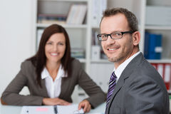 Smiling businessman with a female colleague Royalty Free Stock Images