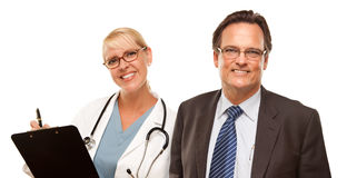 Smiling Businessman with Female Doctor or Nurse Stock Photo