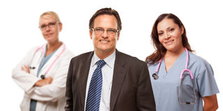 Smiling Businessman with Female Doctor and Nurse Royalty Free Stock Image