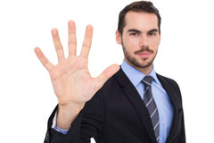 Smiling businessman with fingers spread out Stock Photos