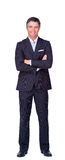 Smiling businessman with folded arms Stock Image