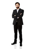 Smiling businessman with folded arms. Royalty Free Stock Photos