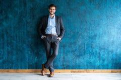 Smiling businessman full length portrait. Isolated on dark blue stock photo