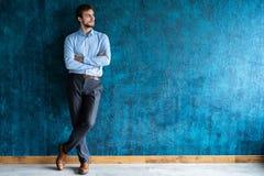 Smiling businessman full length portrait. Isolated on dark blue royalty free stock image
