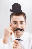 Smiling Businessman with Funny Mask Royalty Free Stock Photos