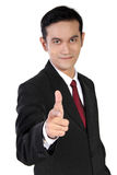 Smiling businessman gesturing gun pointed at you, isolated on wh Stock Photos