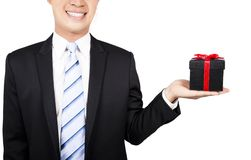 Smiling businessman with a gift Royalty Free Stock Photography