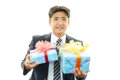 Smiling businessman with a gift Royalty Free Stock Photo