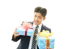 Smiling businessman with gifts stock photos