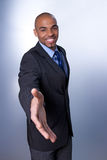 Smiling businessman giving hand Royalty Free Stock Images