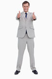 Smiling businessman giving thumbs up Stock Photo