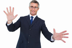 Smiling businessman in glasses with arms out Royalty Free Stock Images