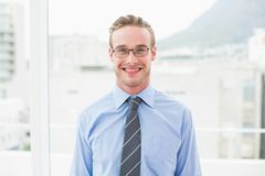 Smiling businessman with glasses standing Royalty Free Stock Photography