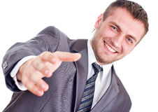 Smiling businessman is going to handshake Stock Image
