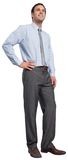 Smiling businessman with hand on hip Stock Photo