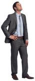 Smiling businessman with hand on hip royalty free stock image