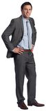 Smiling businessman with hands on hips Stock Images