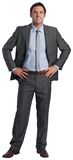 Smiling businessman with hands on hips Stock Photos