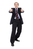 Smiling Businessman with hands pointing. Isolated over white - studio shot Royalty Free Stock Photos